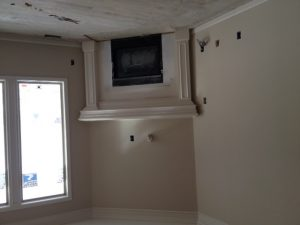 Fireplace and Mantle Progress in New Construction Home